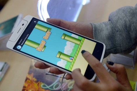 The Vietnamese developer behind the smash-hit free game Flappy Bird has pulled his creation from online stores after announcing that its runaway success had ruined his 'simple life'. (AFP Photo/Hoang Dinh Nam)